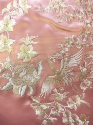 Off white crane embroidery on pink silk satin.