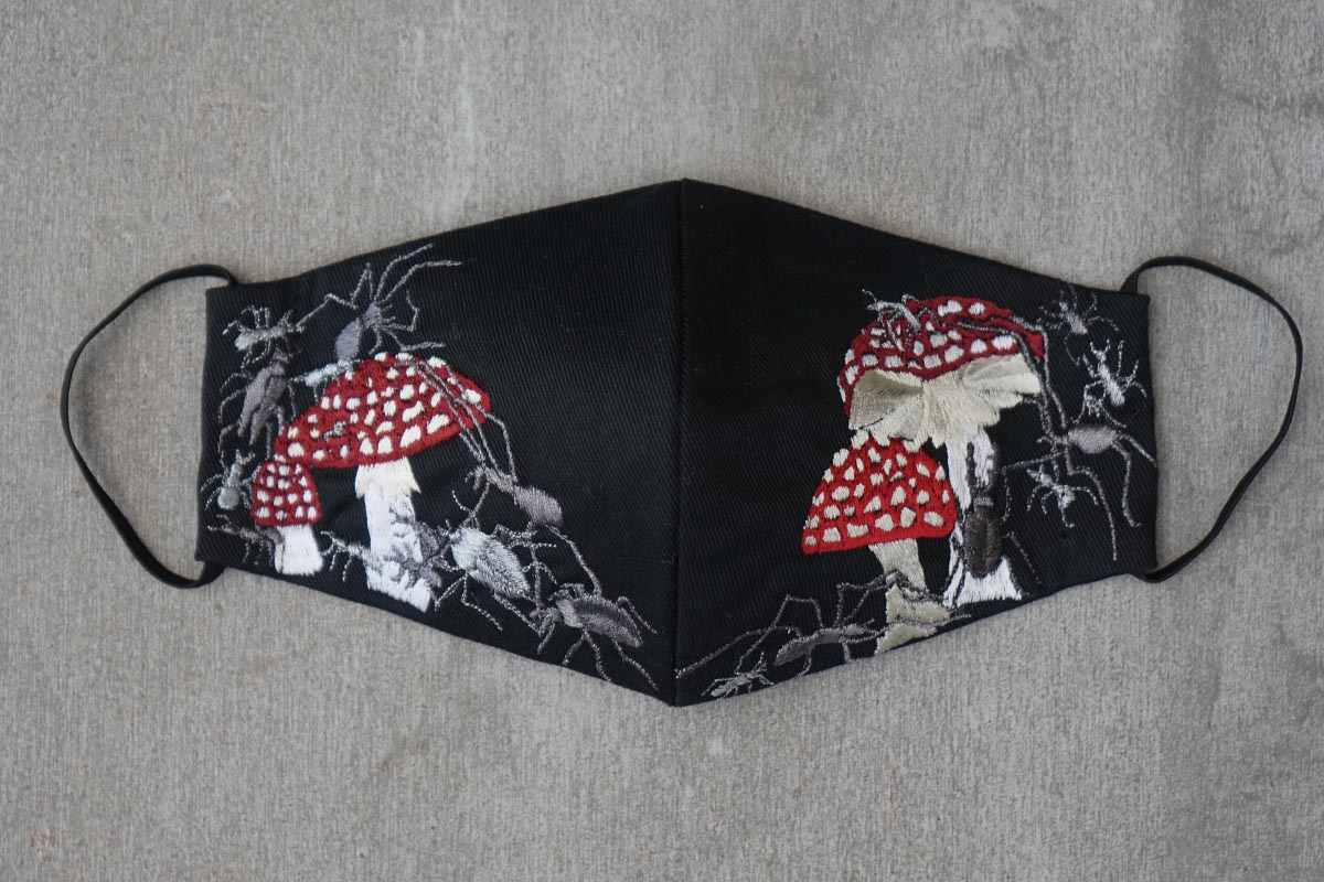 Mushrooms and crawling insects on black cotton reusable face mask