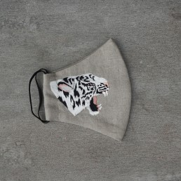 Embroidered White Tiger face mask on Natural Linen by Rachel Rousham.